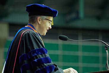 professor speaking at graduation