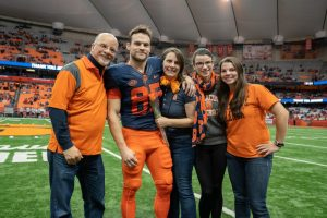Ben Brickman and his family stand on the syracuse football field