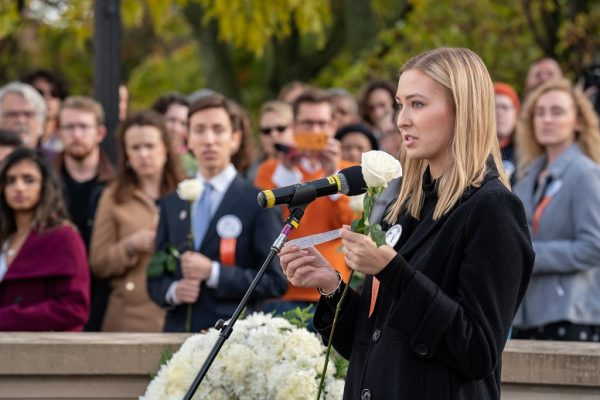 Katie Berrell speaks about her uncle during a ceremony at the Place of Remembrance