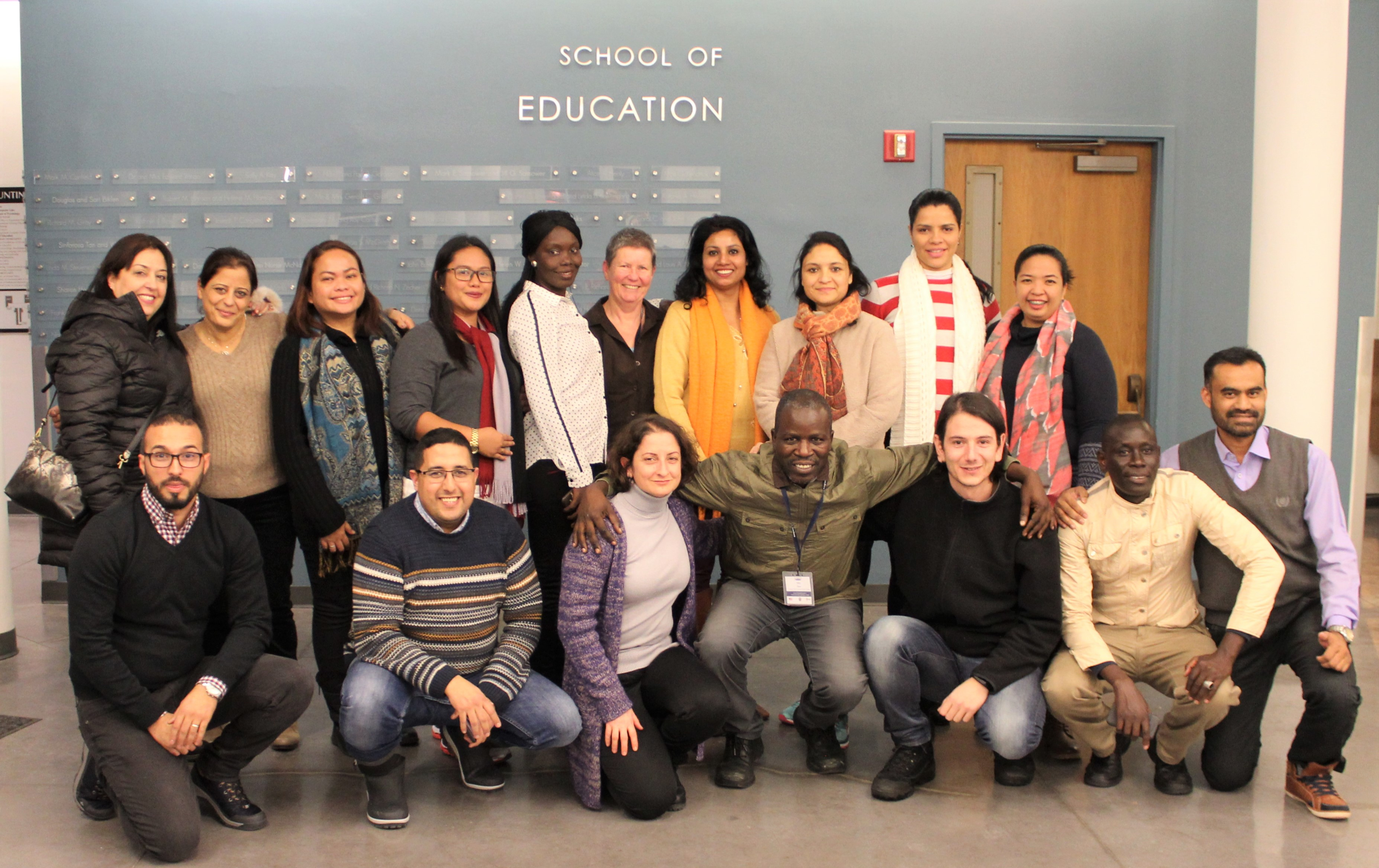 Fulbright Distinguished Teachers pose under the School of Education sign
