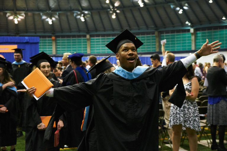 Male master's student cheers at graduation