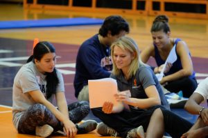 Health and Exercise Science students review placement materials in a gymnasium