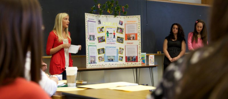 Student presents a posterboard in their class