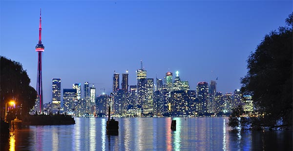 Night photo of the Toronto skyline and harbour
