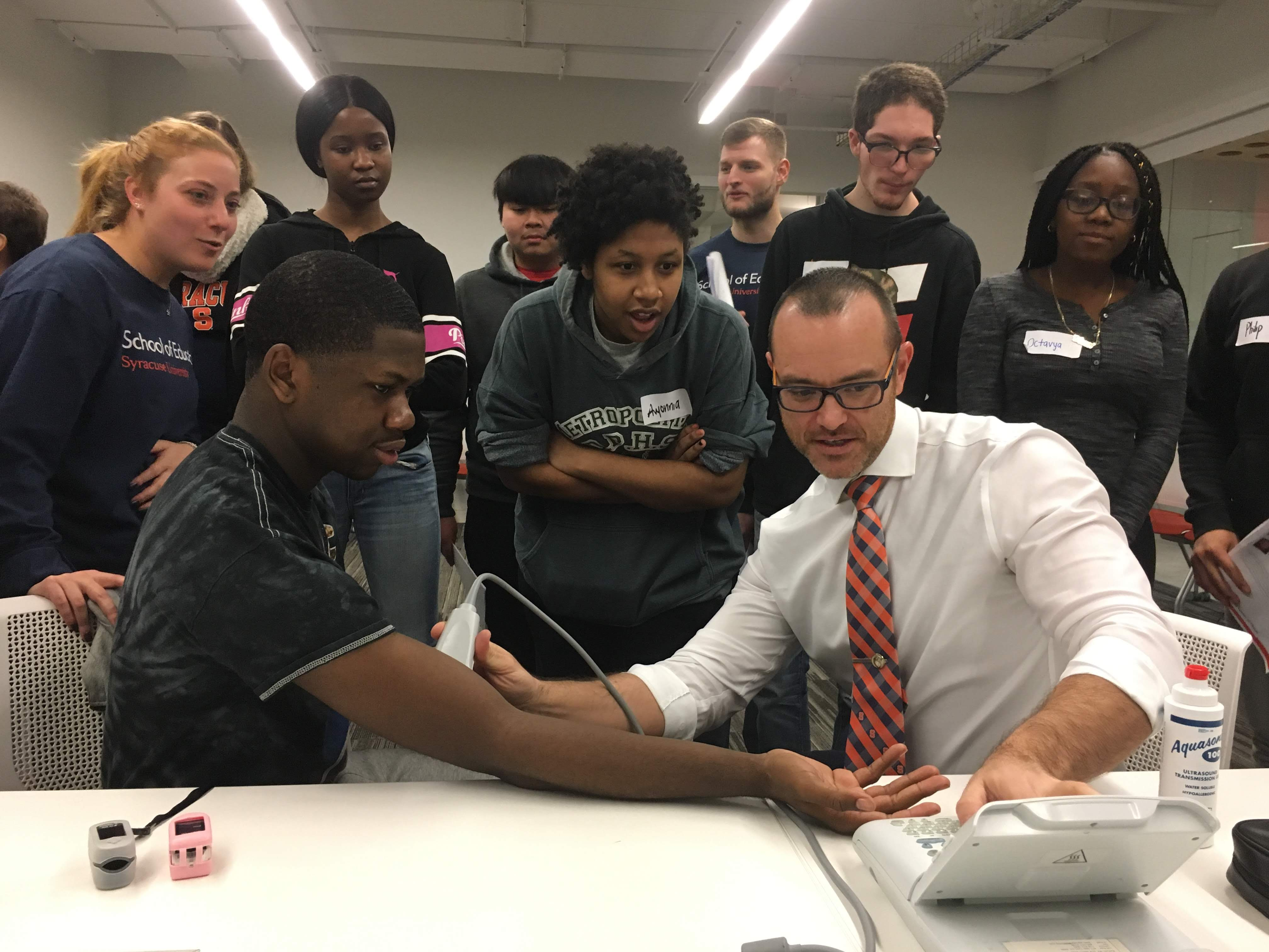 Prof Kevin Heffernan works with exercise science and high school students on a exercise physiology project
