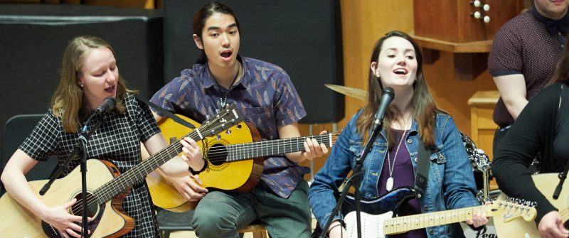Three New American All-Stars sing and play guitar