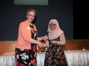 Dean Joanna Masingila presents an award to a student