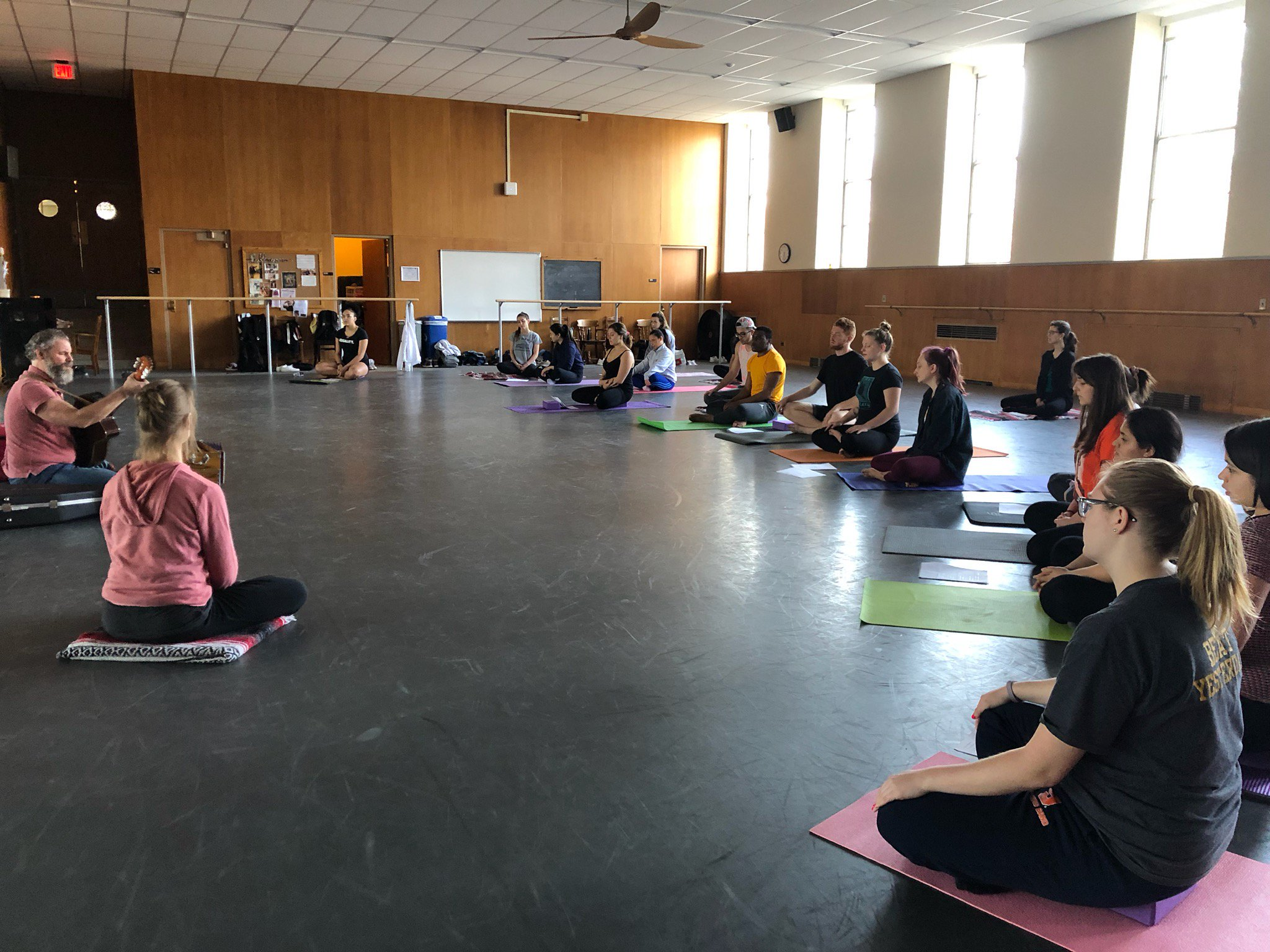 Mark Nanni leads students and faculty in a yoga session