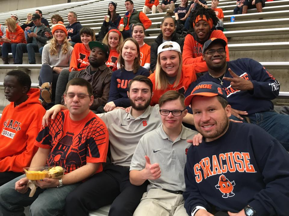 Cleo Hamilton, Tori Cedar, and a group of InclusiveU students and staff attend a Syracuse basketball game
