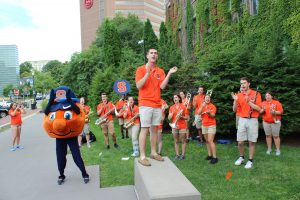 Otto and the S U marching band at a welcome event