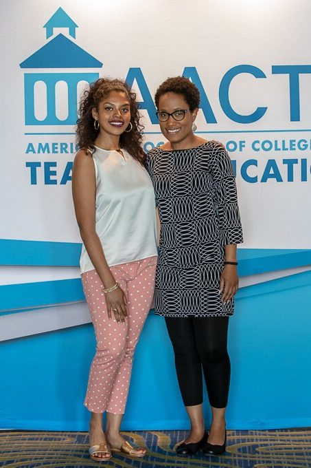 Tiffany Hamm and Phillandra Smith pose in front of an A A C T E banner