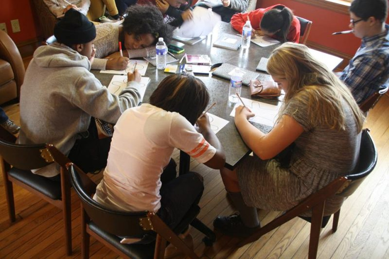 Young writers work on a project during the Writing Our Lives conference in 2014.