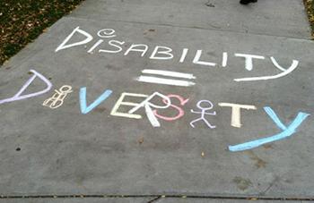 Disability = diversity chalk drawing on sidewalk