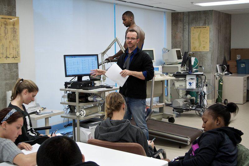 Kevin Heffernan leads a class in observing an athlete on a treadmill