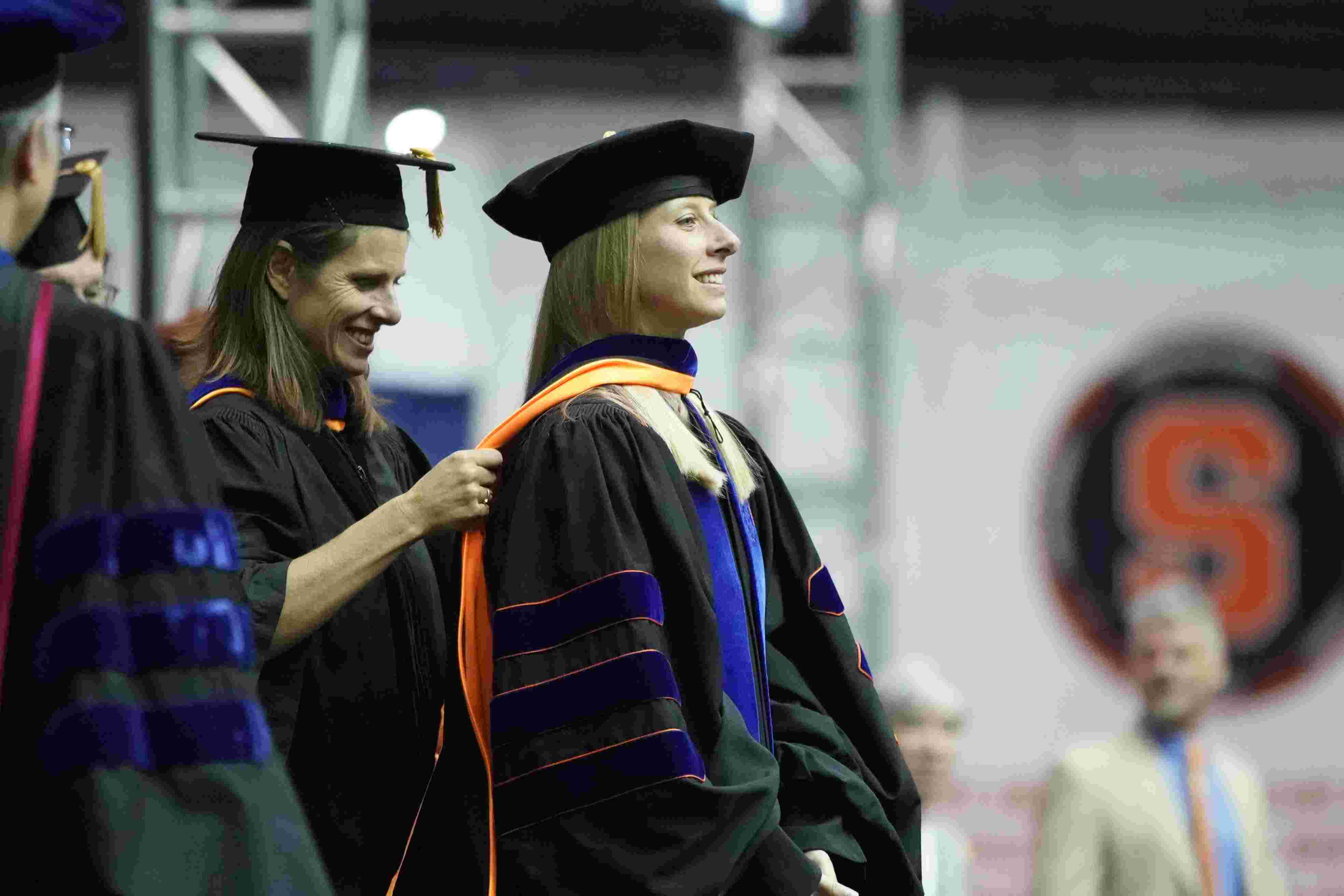 Doctoral student being hooded at graduation