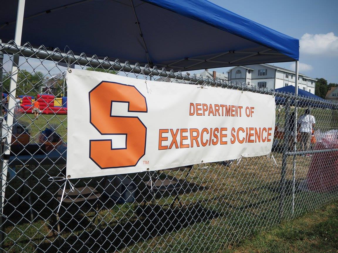 Exercise science banner hung on the women's building fence