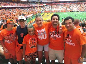 Harry Dydo with InclusiveU classmates and peer mentors at a syracuse football game