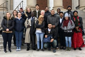 2020 Fulbright scholars stand on the steps of Carnegie Library