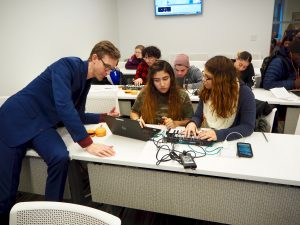 David Knapp works with students from the Leadership and Public Service High School in New York City.