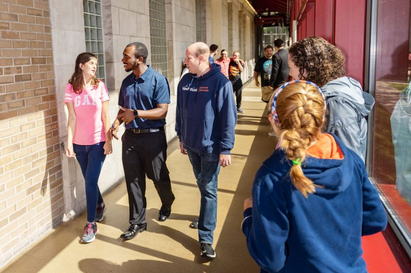 InclusiveU students and mentors walking in Huntington Hall