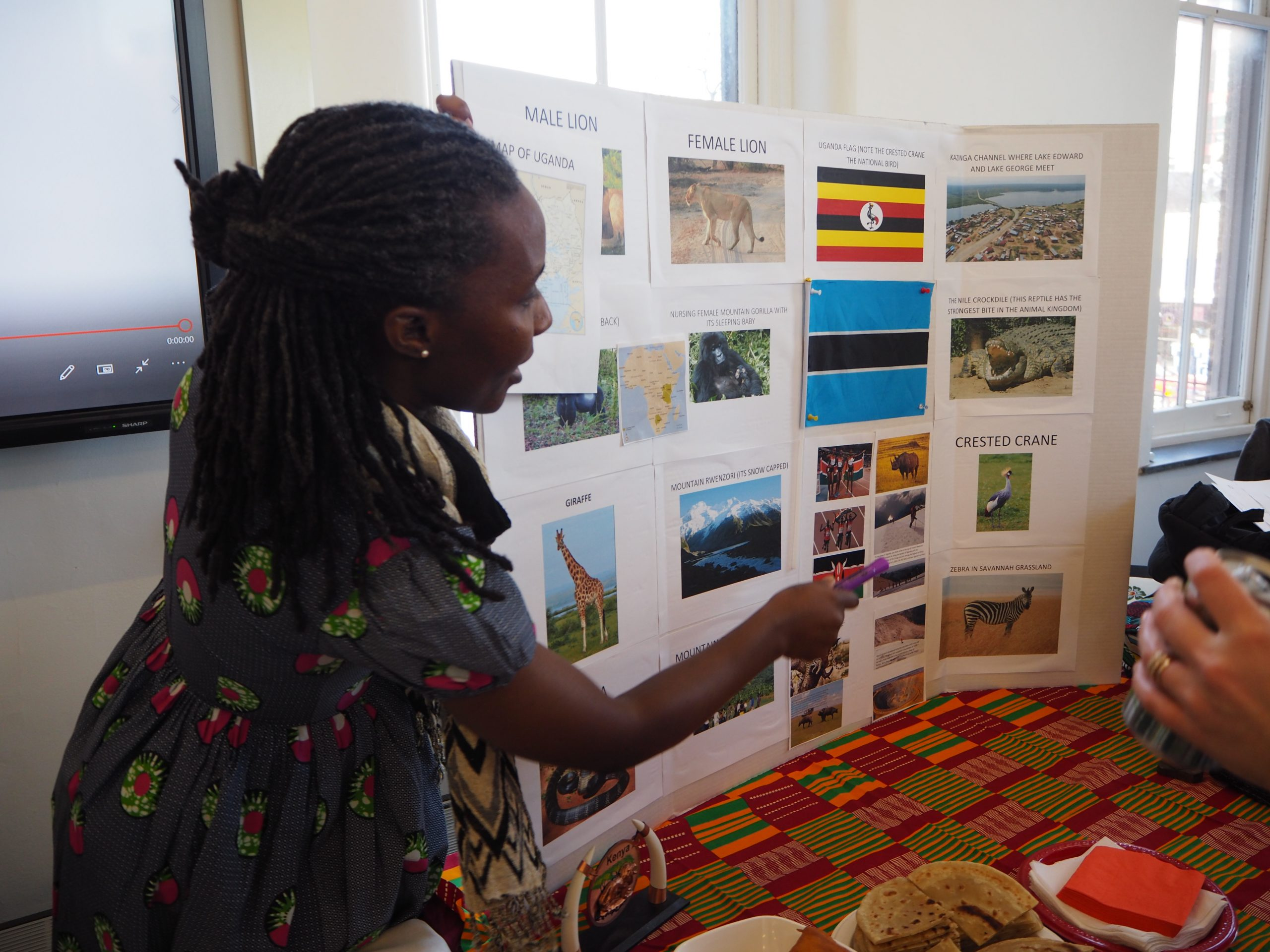 a student from uganda shows off her display