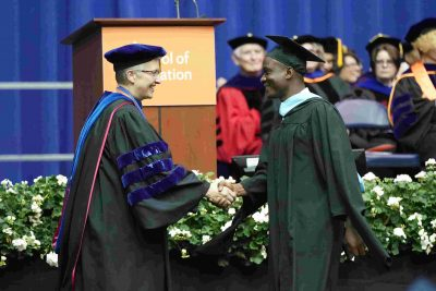 Whorway receiving his master's at convocation in 2019