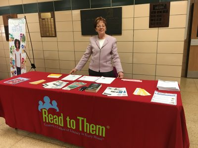 curcio tabling for read to them at a community event