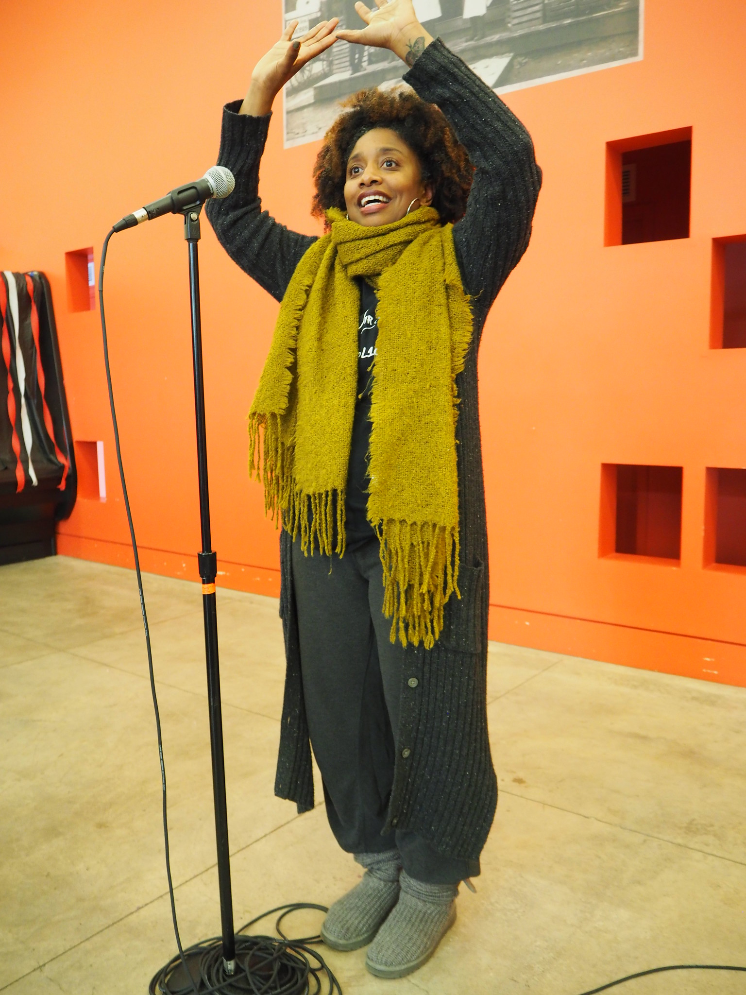 Marcelle Haddix holds up her hands in a heart shape at the writing our lives tenth anniversary celebration