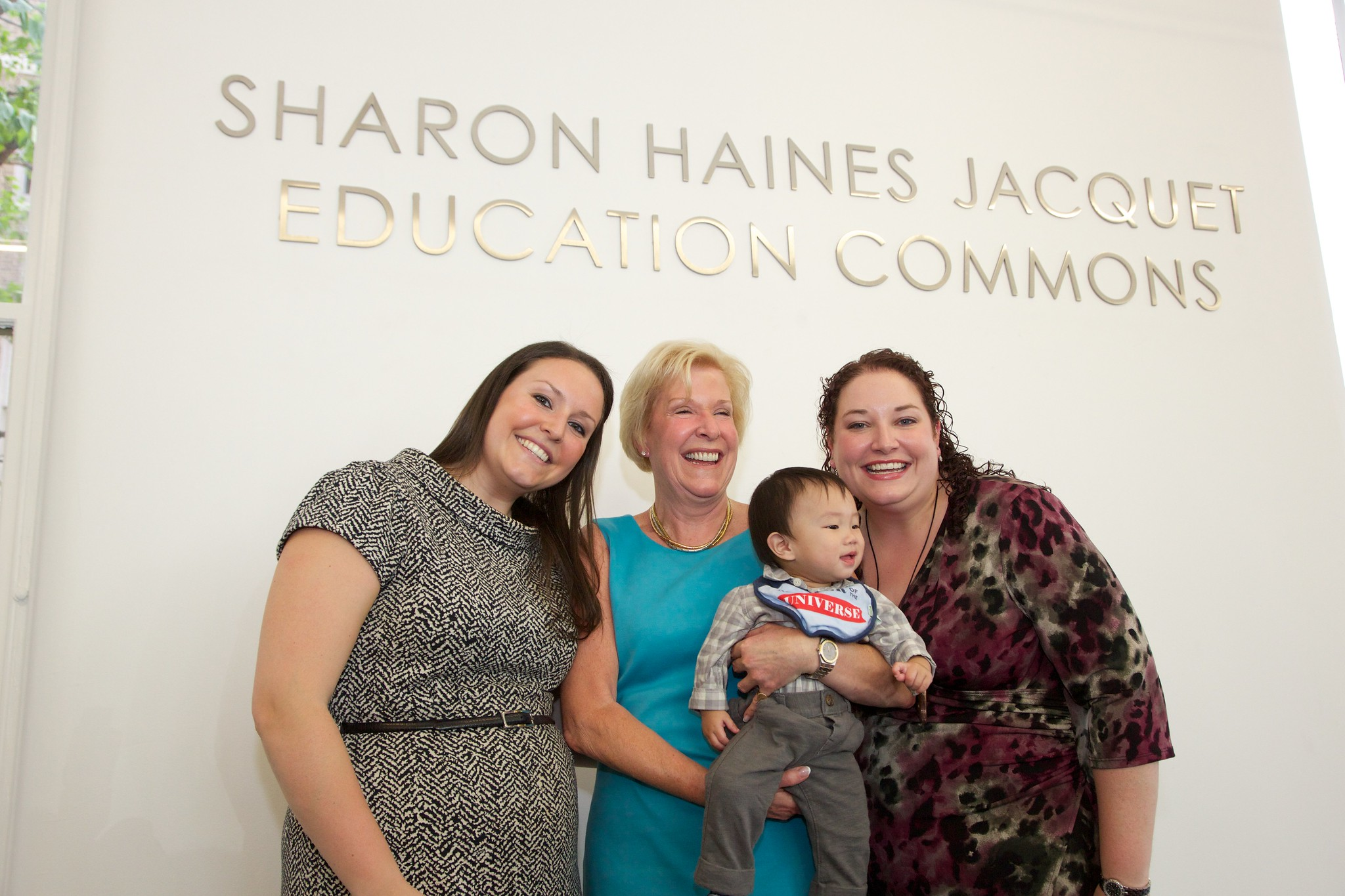Sharon Jacquet (center) with family at the dedication of the Sharon Haines Jacquet Education Commons in May 2013