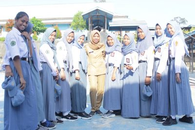 Yuli with students in Indonesia